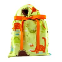 Colorful dinosaurs on a green gift bag with an orange grosgrain ribbon standard