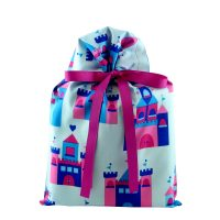 pink and blue fairy tale castles on a blue gift bag with violet ribbon