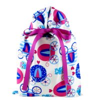 princess coaches and frog princes on a white gift bag with violet ribbon